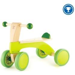 Bicicleta verde de madera sin pedales